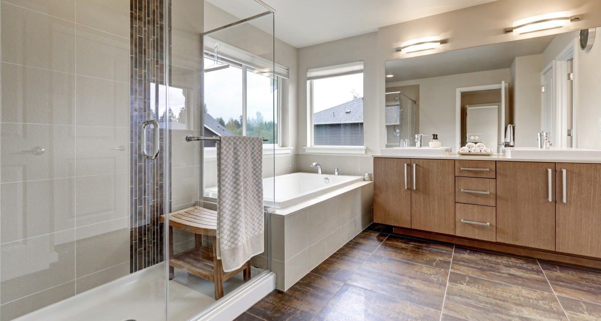 Bathroom with double vanity and a combination of a bath and a shower